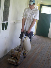 Sanding down the newly discovered hardwood floor
