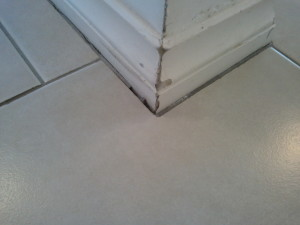 Cracking in the Grout between the tile and baseboard trim