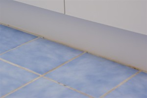 Cracked and Damaged Grout Against Vanity
