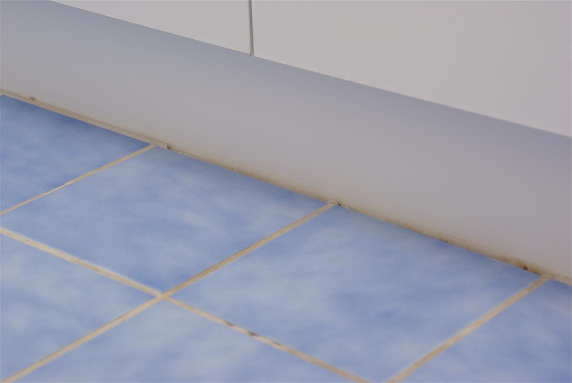 Should You Tile Under Bathroom Vanities Or Kitchen