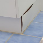 Water Damaged Bathroom Vanity Grouted Into Tile