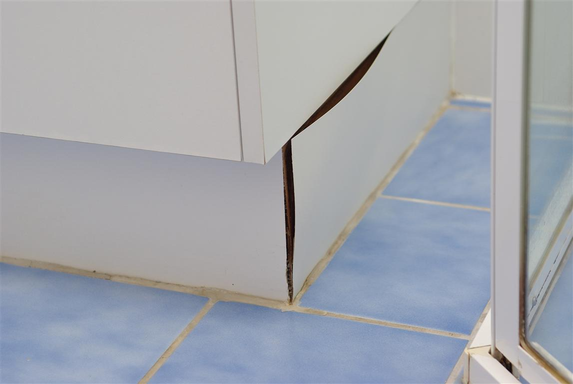 should you tile under bathroom vanities or kitchen