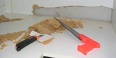 Damaged Portion Of Kitchen Cabinet Mdf Melamine Removed With Skill Saw And Box Cutter